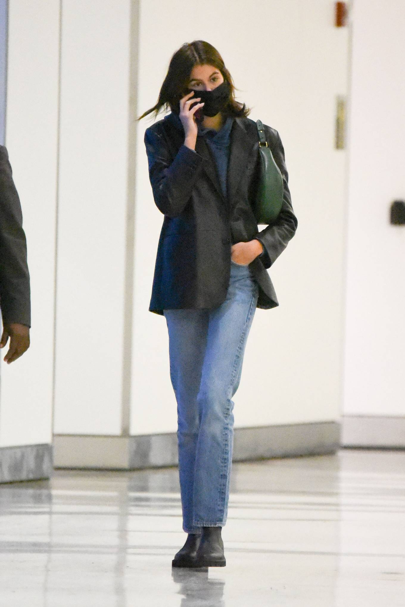 Kaia Gerber wearing round black leather ankle chelsea boots by Celine with cuban heel