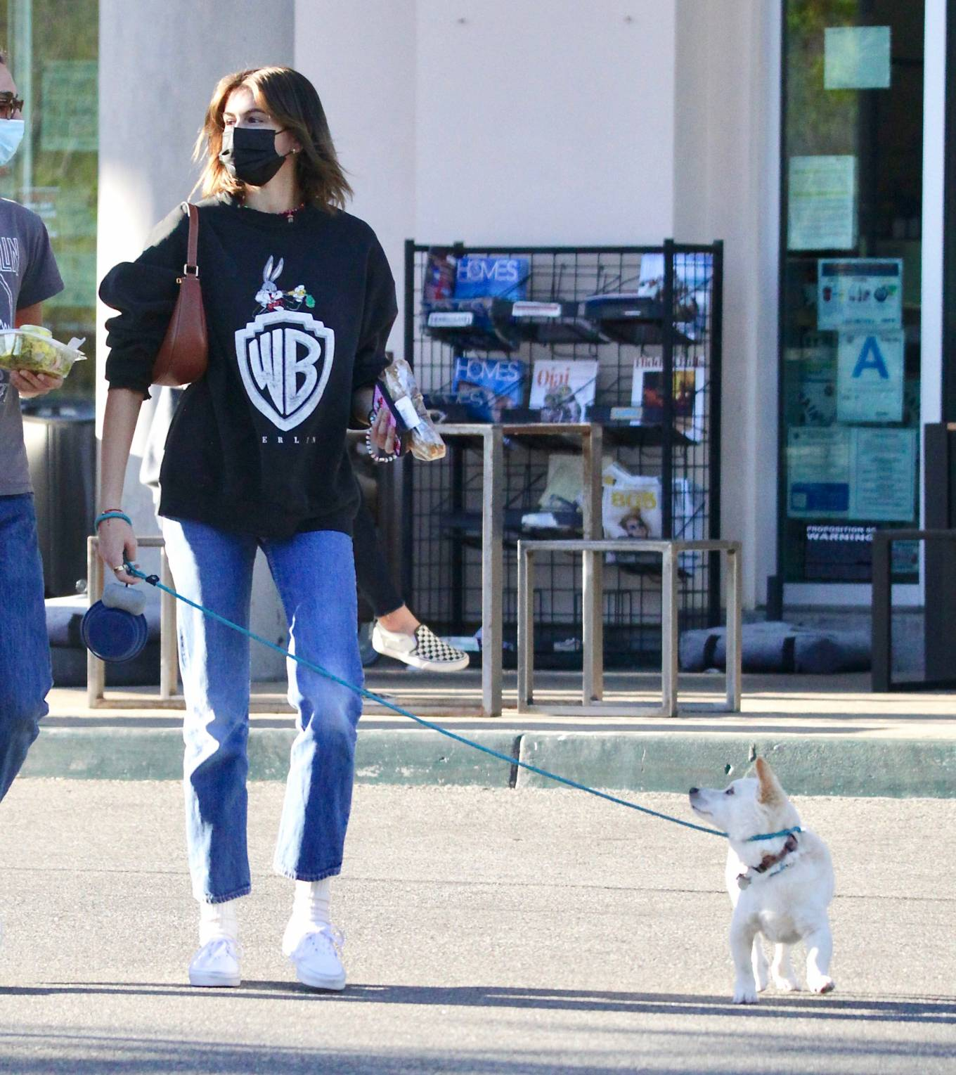 Kaia Gerber wearing round white lace-up sneakers