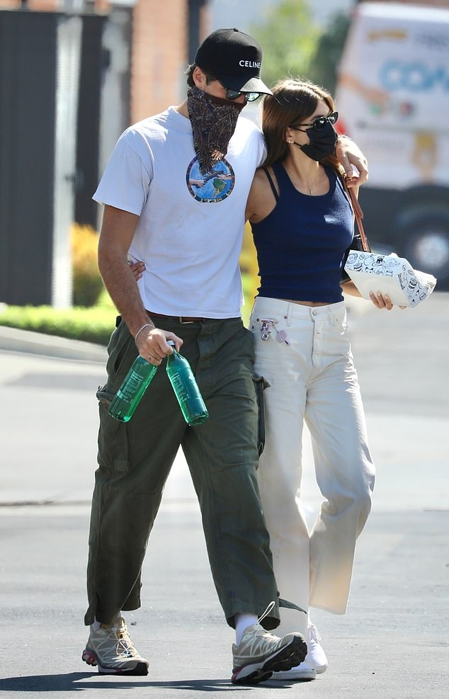 Kaia Gerber rocking straight fit off white button front ankle length jeans with high waist