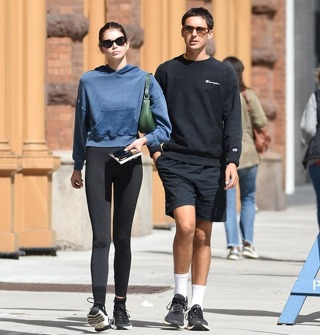 Kaia Gerber donning brand logo black Nike lace-up sneakers