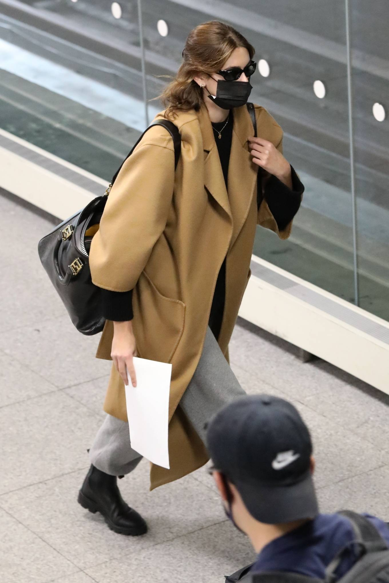 Kaia Gerber rocking round black leather ankle boots by Celine with cuban heel