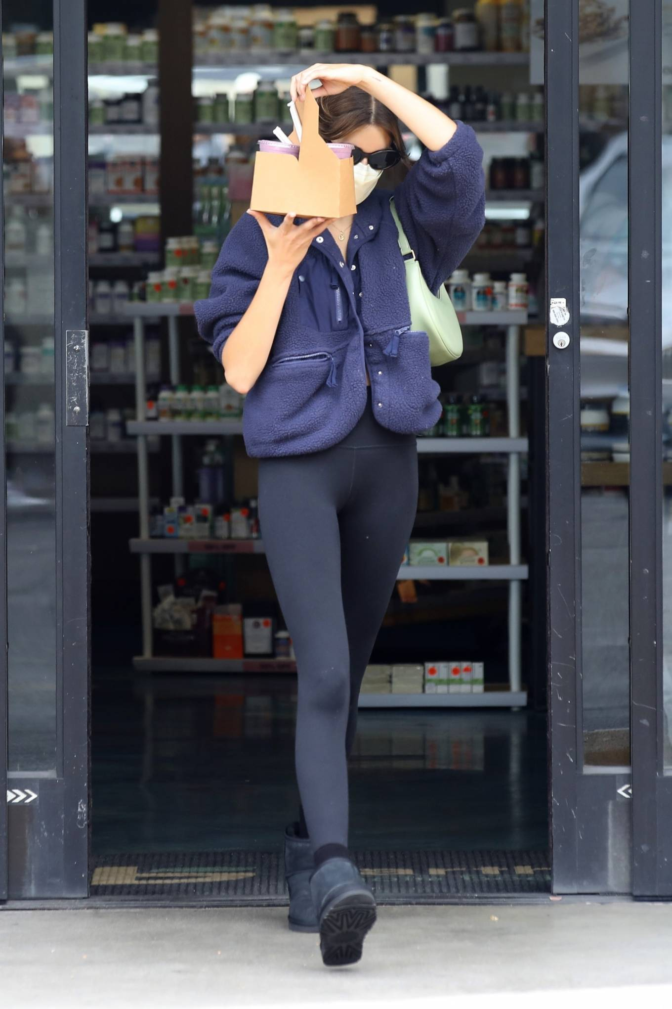 Kaia Gerber donning round black Ugg ankle boots with flat heel