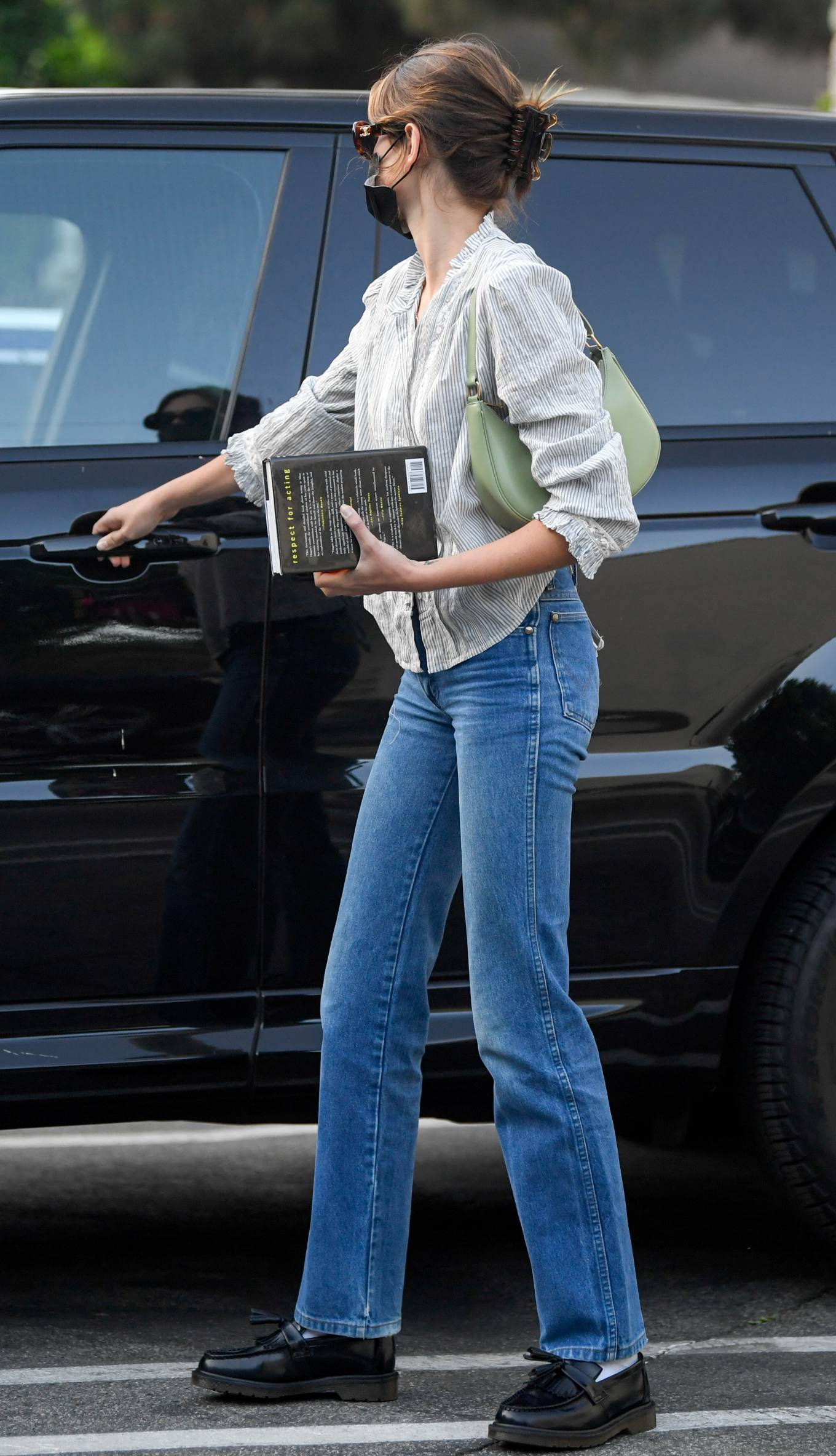Kaia Gerber wearing round black leather shoes by Dr. Martens