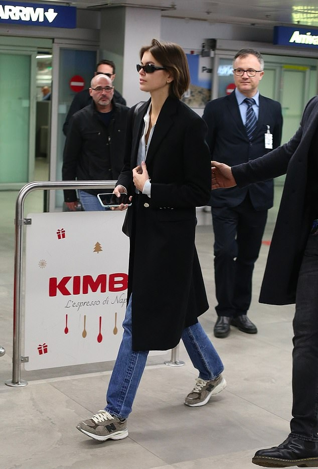 Kaia Gerber wearing a white cotton shirt with full sleeves, shirt collar and button front