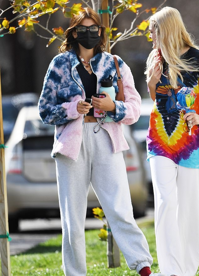 Kaia Gerber rocking loose fit grey elastic hem ankle length sweatpants