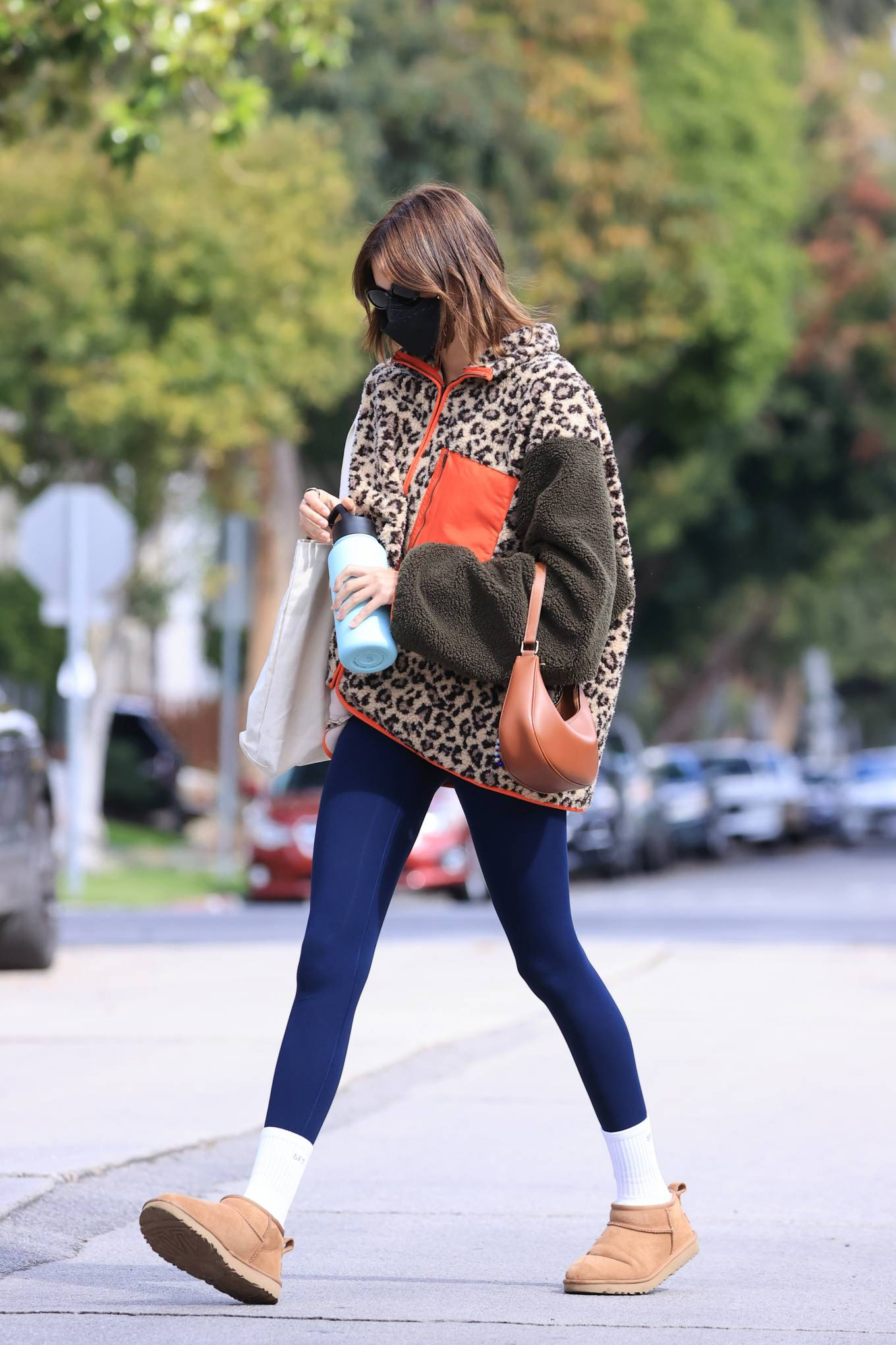 Kaia Gerber rocking a oversized leopard print jacket with a fleece fabric, full sleeves and drop shoulder