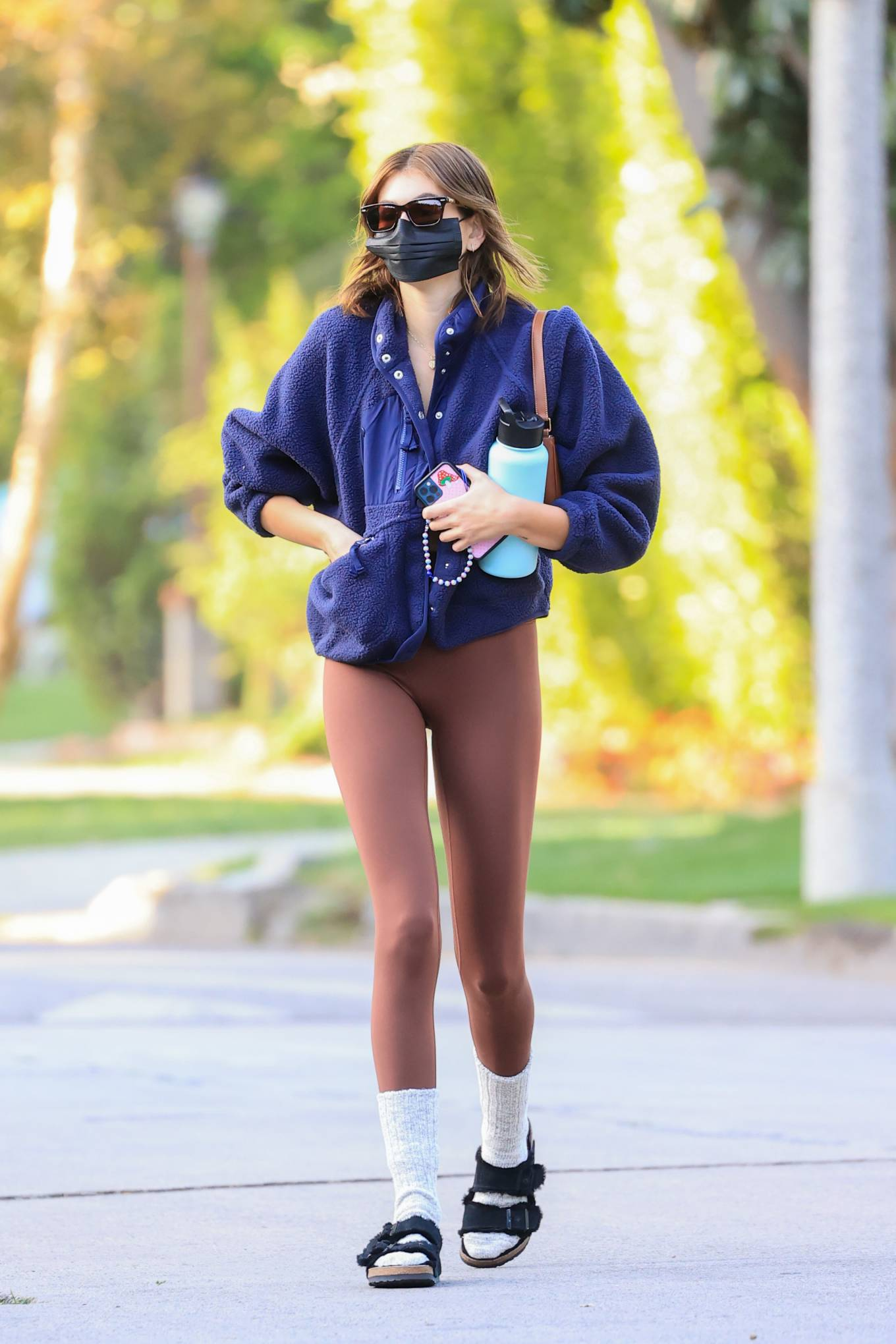 Kaia Gerber wearing fitted brown basic workout leggings
