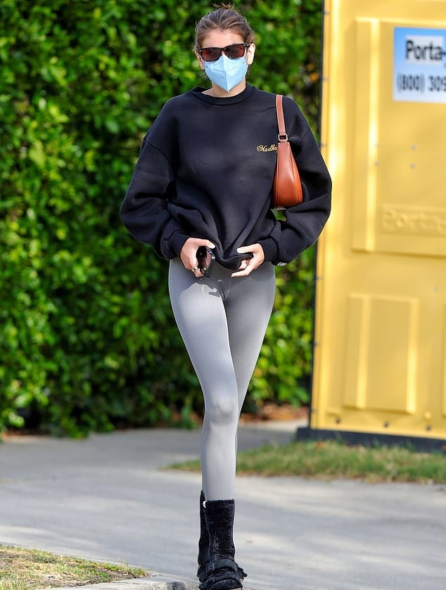 Kaia Gerber donning round black suede open toe sandals by Birkenstock with flat heel