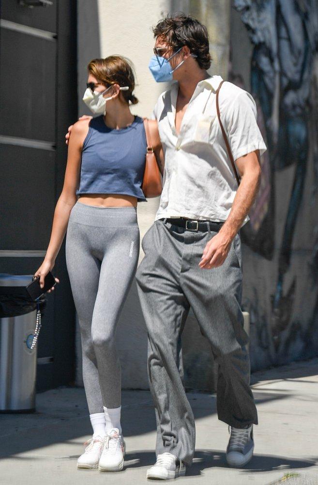 Kaia Gerber rocking narrow fit grey high rise workout leggings