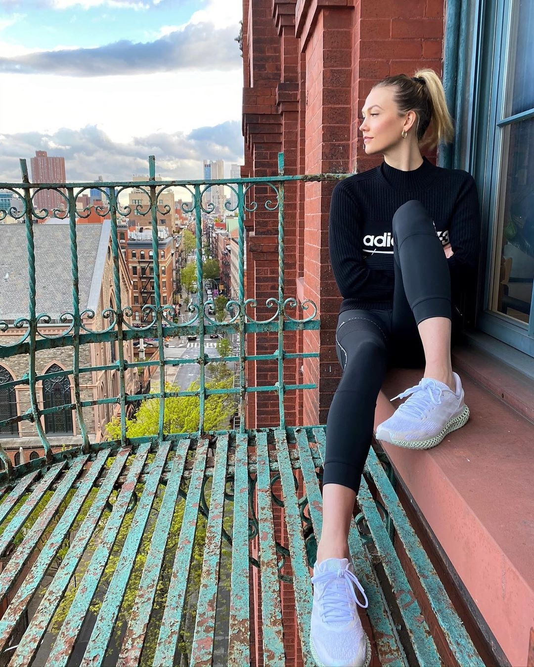 Karlie Kloss donning white mesh lace-up sneakers