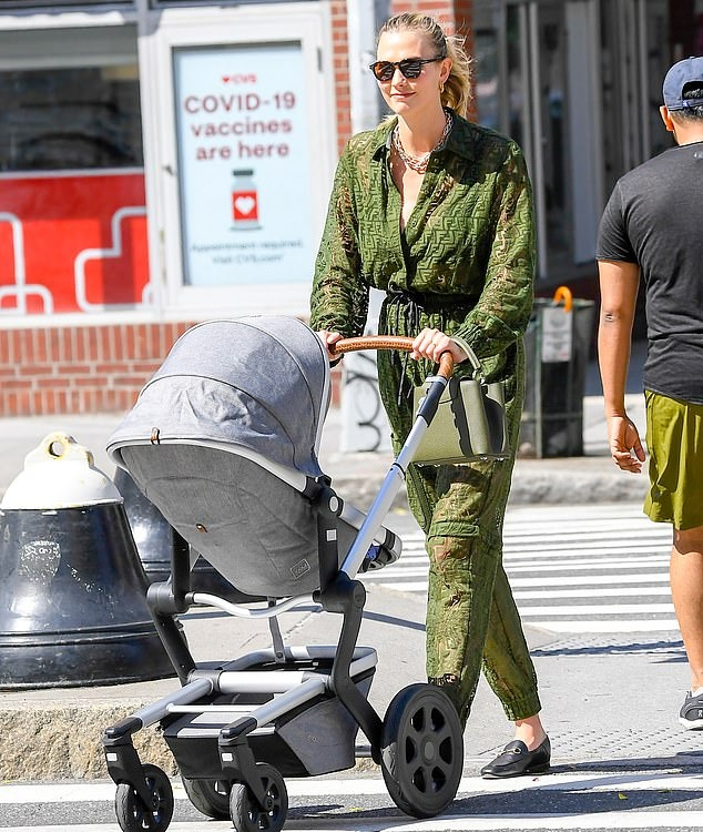 Karlie Kloss rocking a semi-sheer olive green jumpsuit by Fendi while out and about in New York