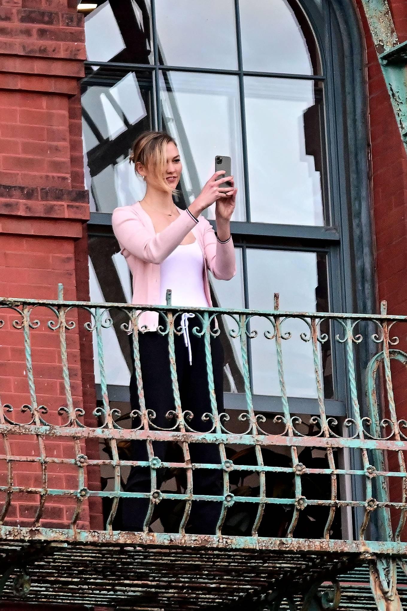 Karlie Kloss wearing Black high waist trousers
