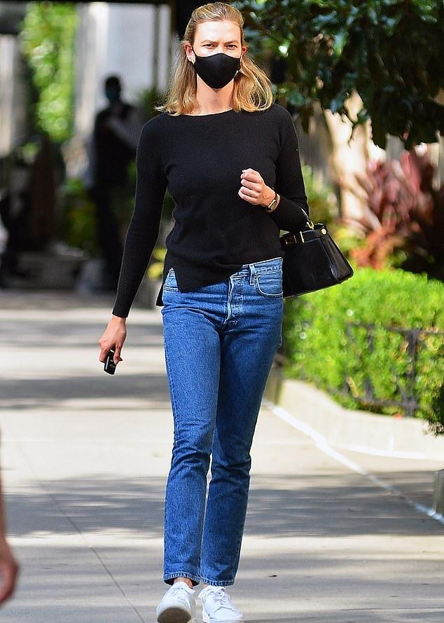 Karlie Kloss wearing straight fit blue denim jeans
