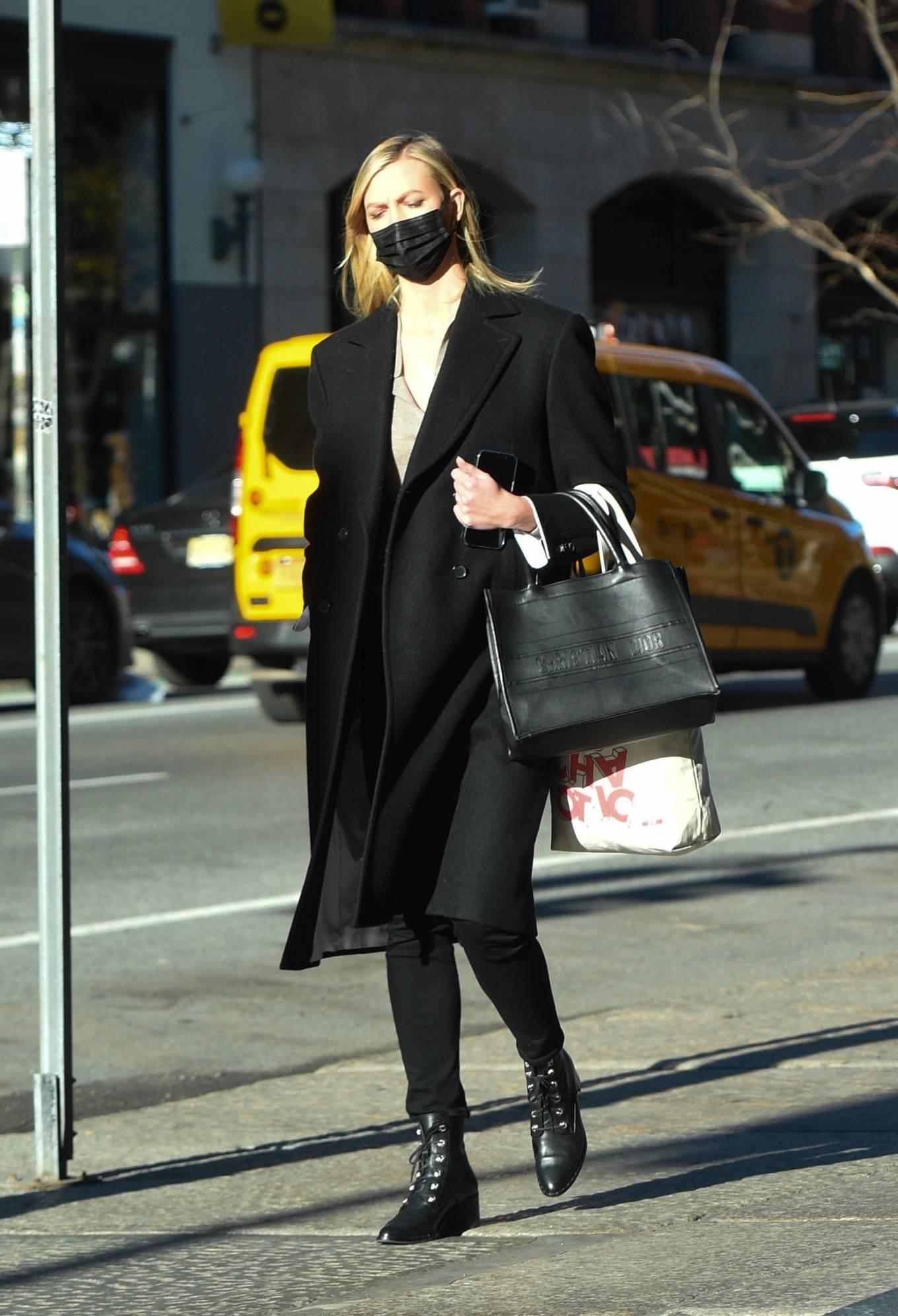 Karlie Kloss carrying a brand logo Dior calfskin tote