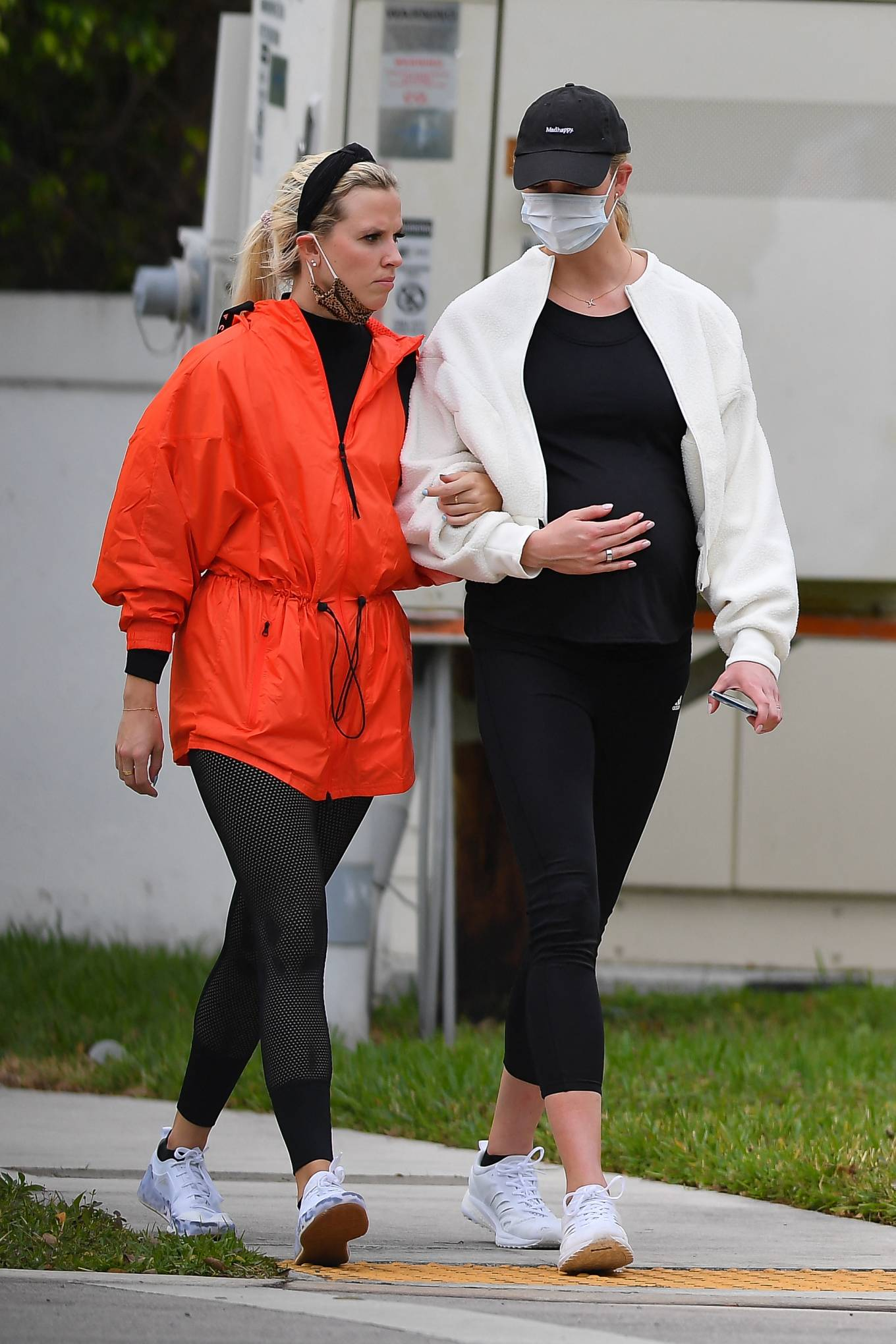 Karlie Kloss rocking a loose fit off white Adidas polyester sweatshirt with bell sleeves, side pockets and elastic hem