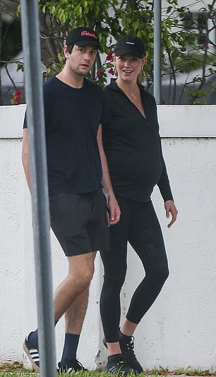Karlie Kloss wearing round black lace-up sneakers with chunky sole