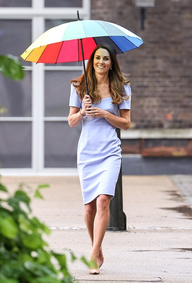 Kate Middleton donning a flattering lilac dress that showed off her model figure