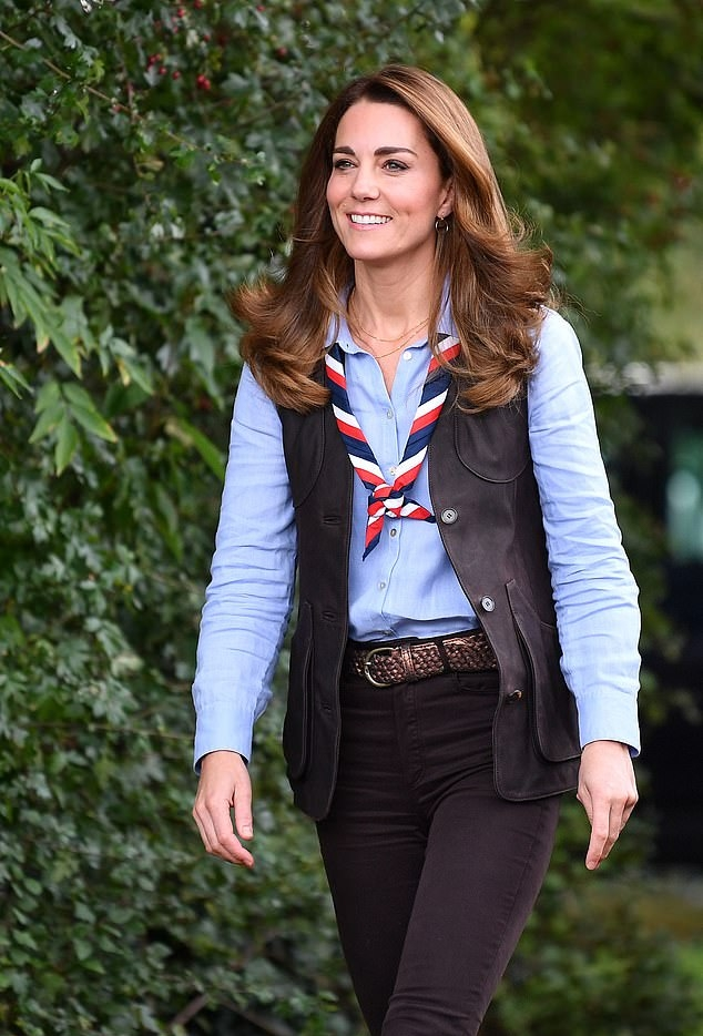 Kate Middleton rocking black suede ankle boots