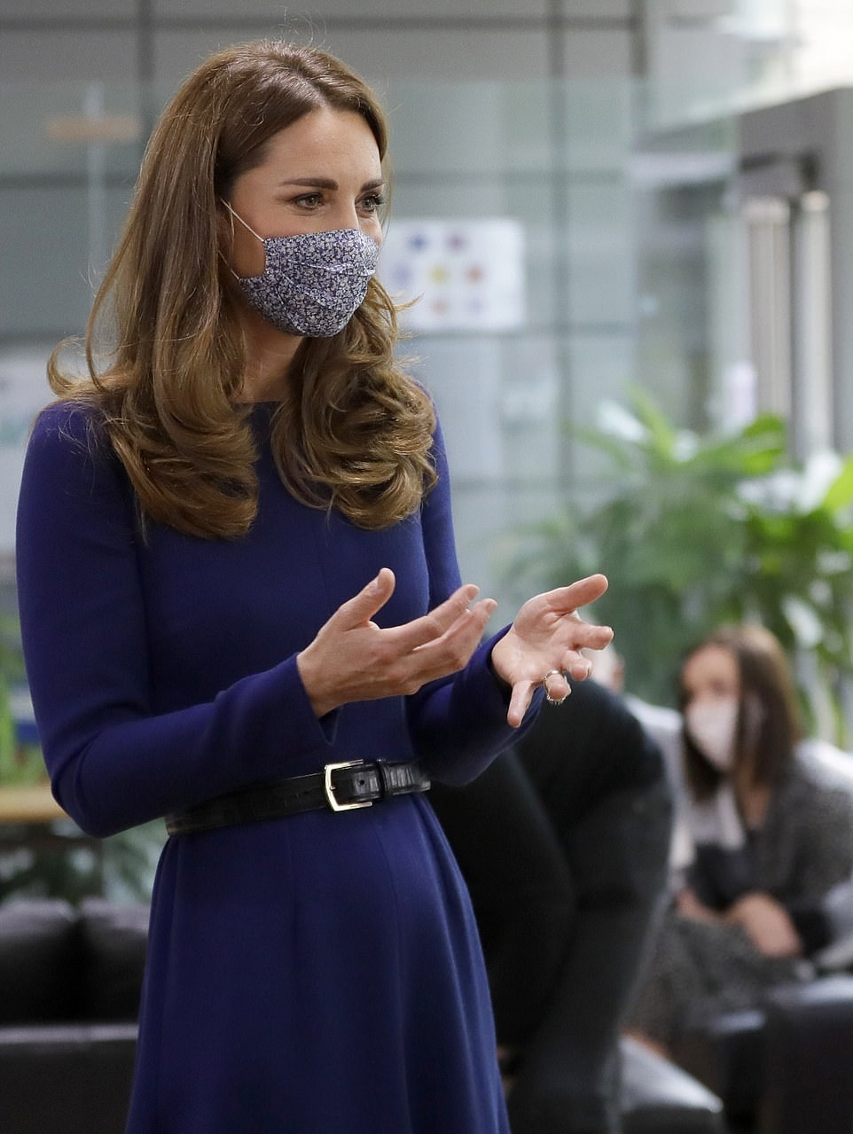 Kate Middleton donning a flare Royal blue dress with full sleeves, a crew neck and cinched waist