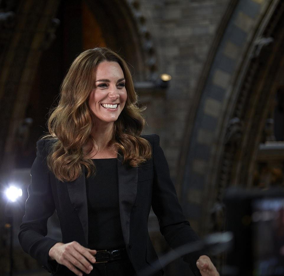 Kate Middleton rocking a figure hugging black dress with a square neck