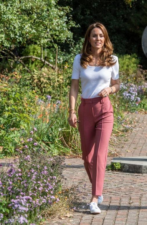 Kate Middleton wearing white lace-up sneakers