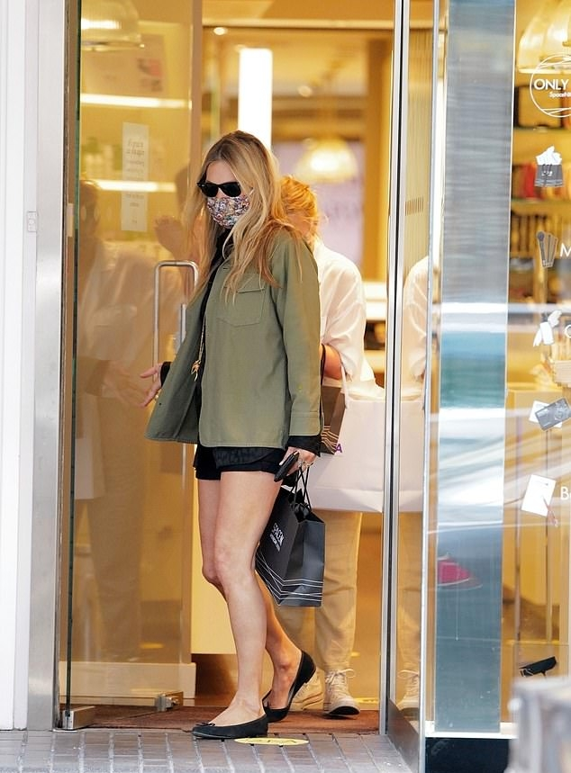 Kate Moss wearing narrow black suede ballerina