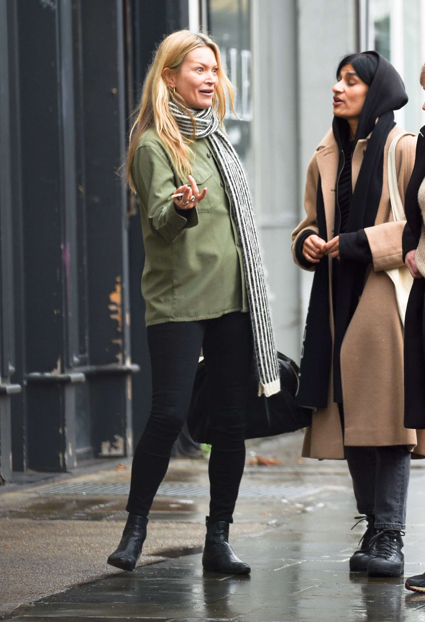 Kate Moss wearing black leather ankle boots with square heel