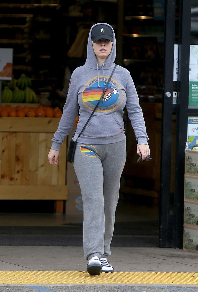Katy Perry donning a Grey hooded Aviator Nation hoodie with extra long sleeves