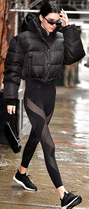 Kendall Jenner donning a oversized black Balenciaga quilted jacket with extra long sleeves