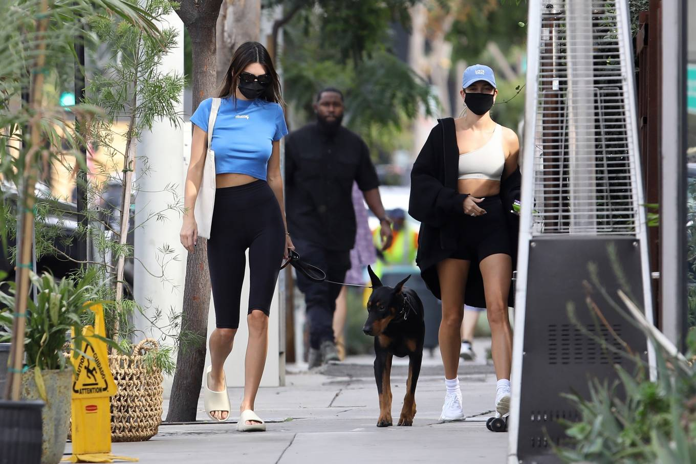 Kendall Jenner wearing a blue basic crop top with cap sleeves and a crew neck