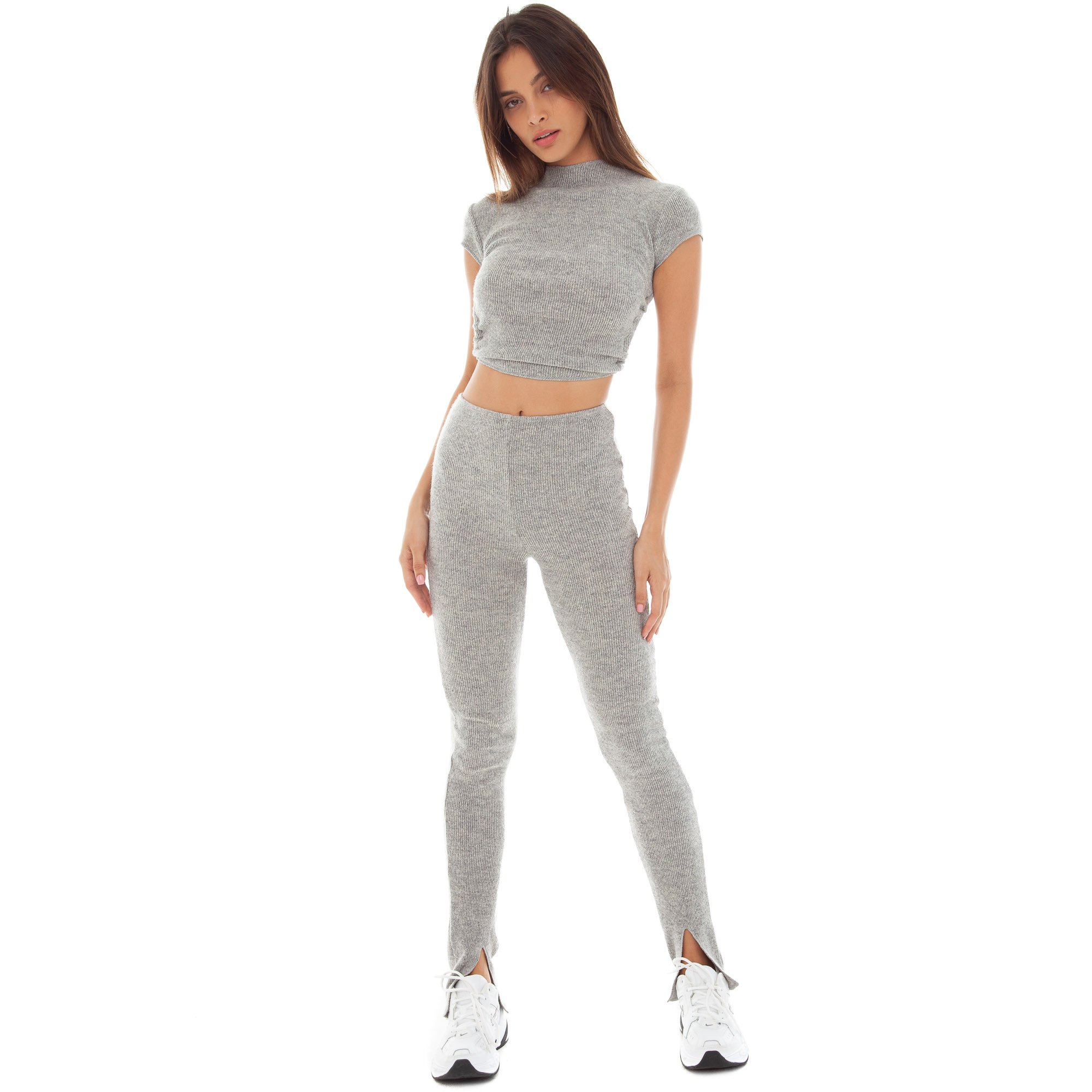 Kendall Jenner wearing a grey basic crop top with short sleeves, cut out and a crew neck