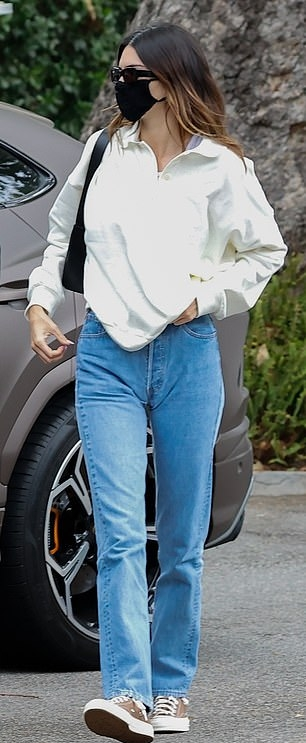 Kendall Jenner wearing brand logo brown Converse ankle canvas shoes with flat heel