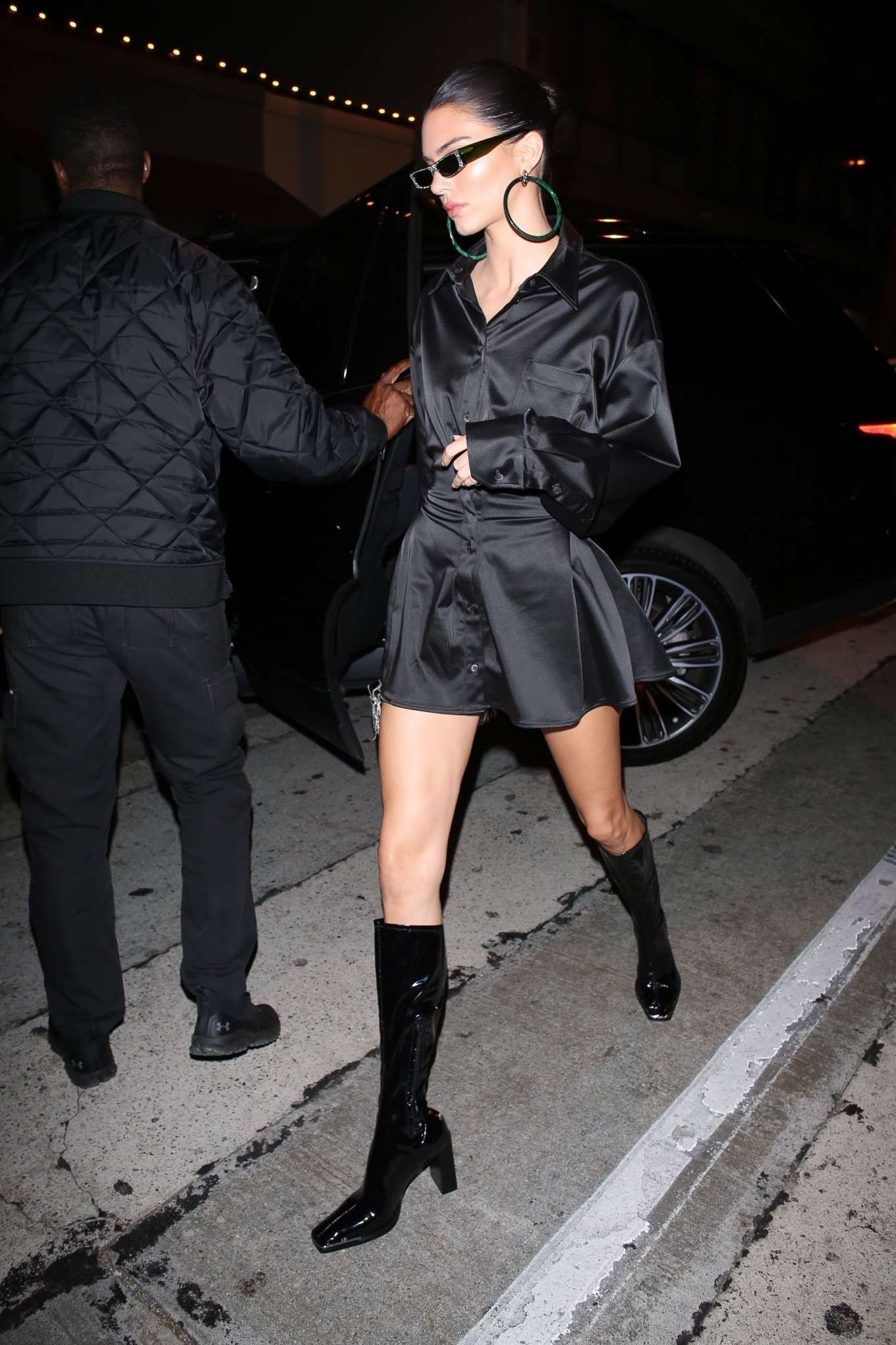 Kendall Jenner rocking narrow black Jacquemus knee high boots with block heel