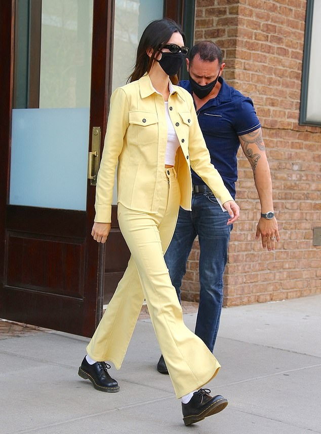 Kendall Jenner wearing a Light yellow open front shirt with a twill fabric, full sleeves, shirt collar and button front