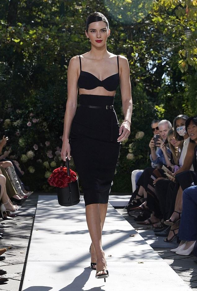 Kendall Jenner rocking square black slingback sandals with stiletto heels