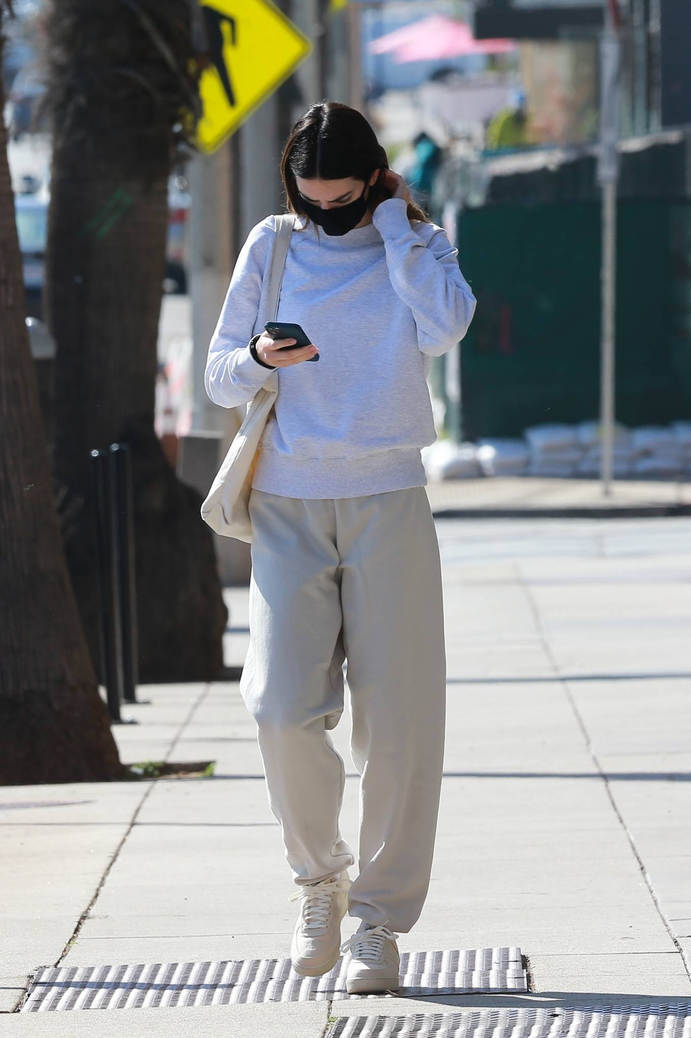 Kendall Jenner rocking brand logo cream Nike lace-up sneakers