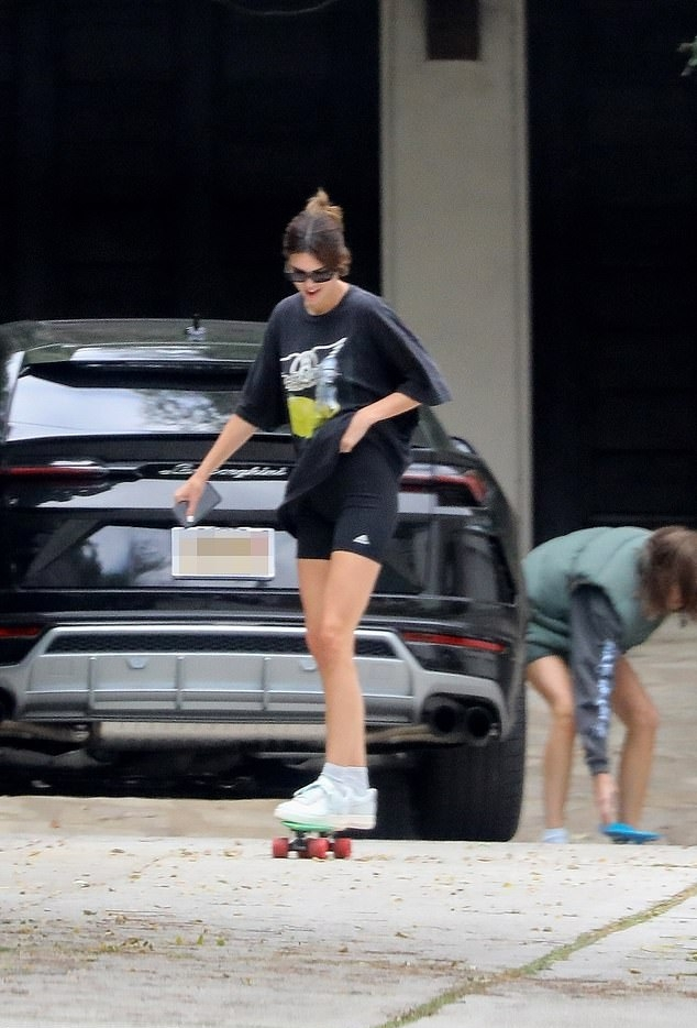Kendall Jenner donning round white Nike lace-up sneakers