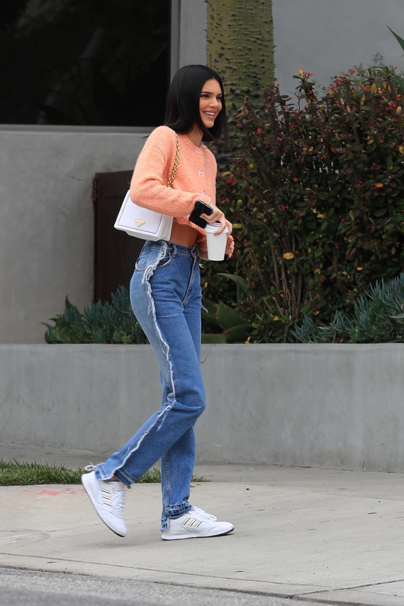 Kendall Jenner rocking striped white Adidas lace-up sneakers