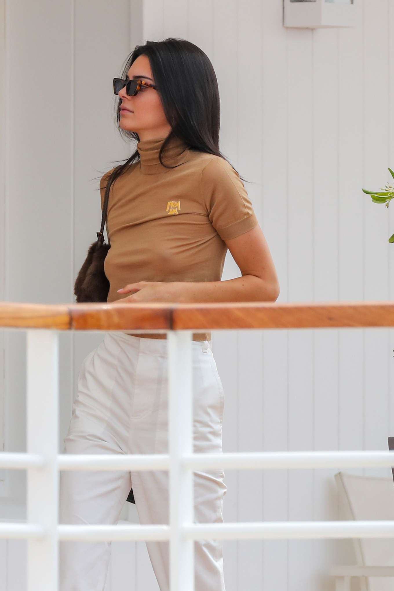 Kendall Jenner rocking Baggy white high rise pants with side pockets