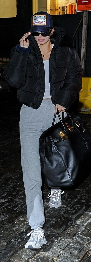 Kendall Jenner donning grey Reebok lace up sneakers