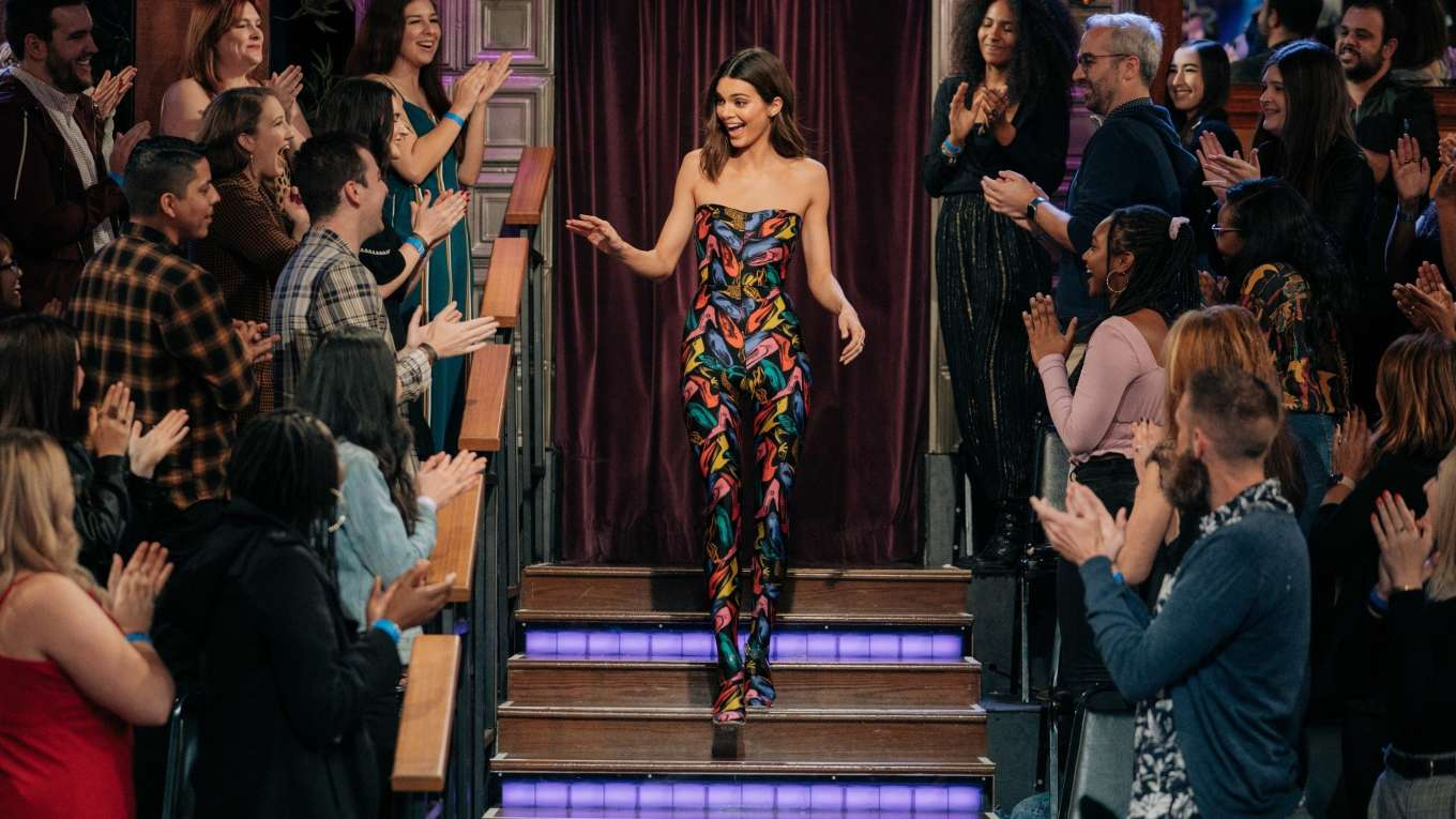 Kendall Jenner donning a Formfitting Salvatore Ferragamo shoe printed jumpsuit with shoe printed