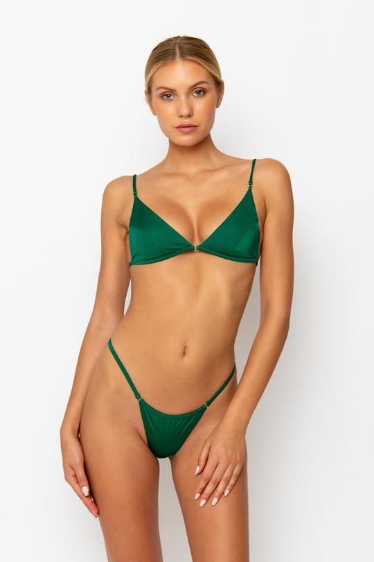 Kendall Jenner rocking a plunging bottle green bikini top with spaghetti straps