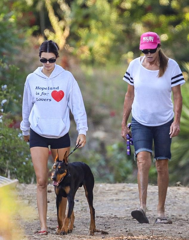 Kendall Jenner wearing Black skinny bite shorts while hiking with dad Caitlyn Jenner and her beloved pup Pyro in Malibu