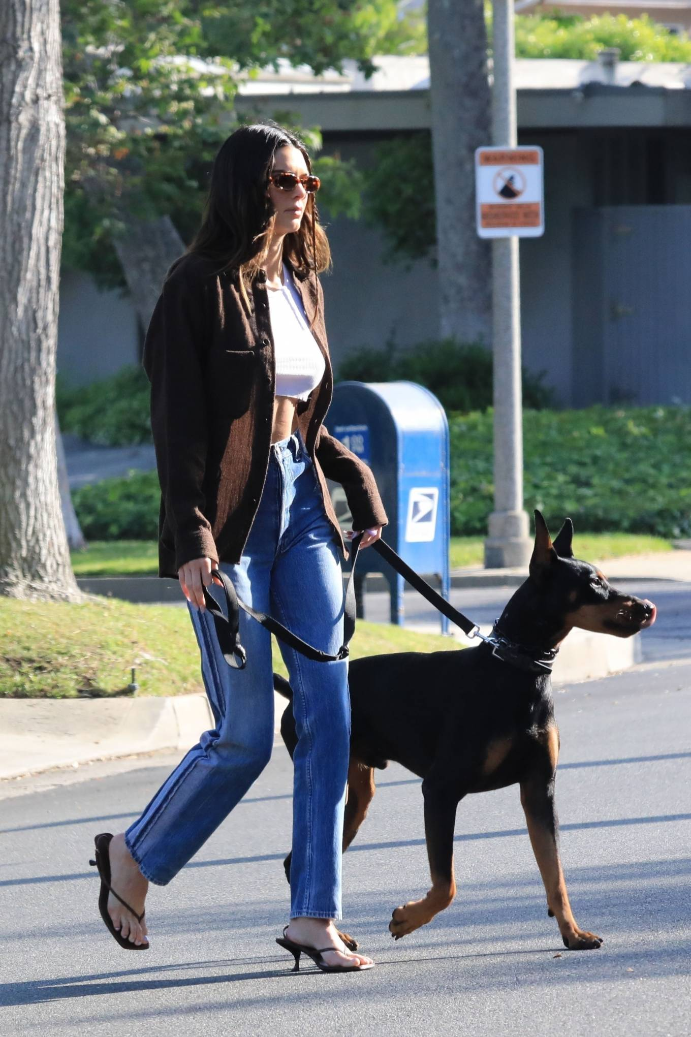 Kendall Jenner rocking square black leather slip on sandals by The Row