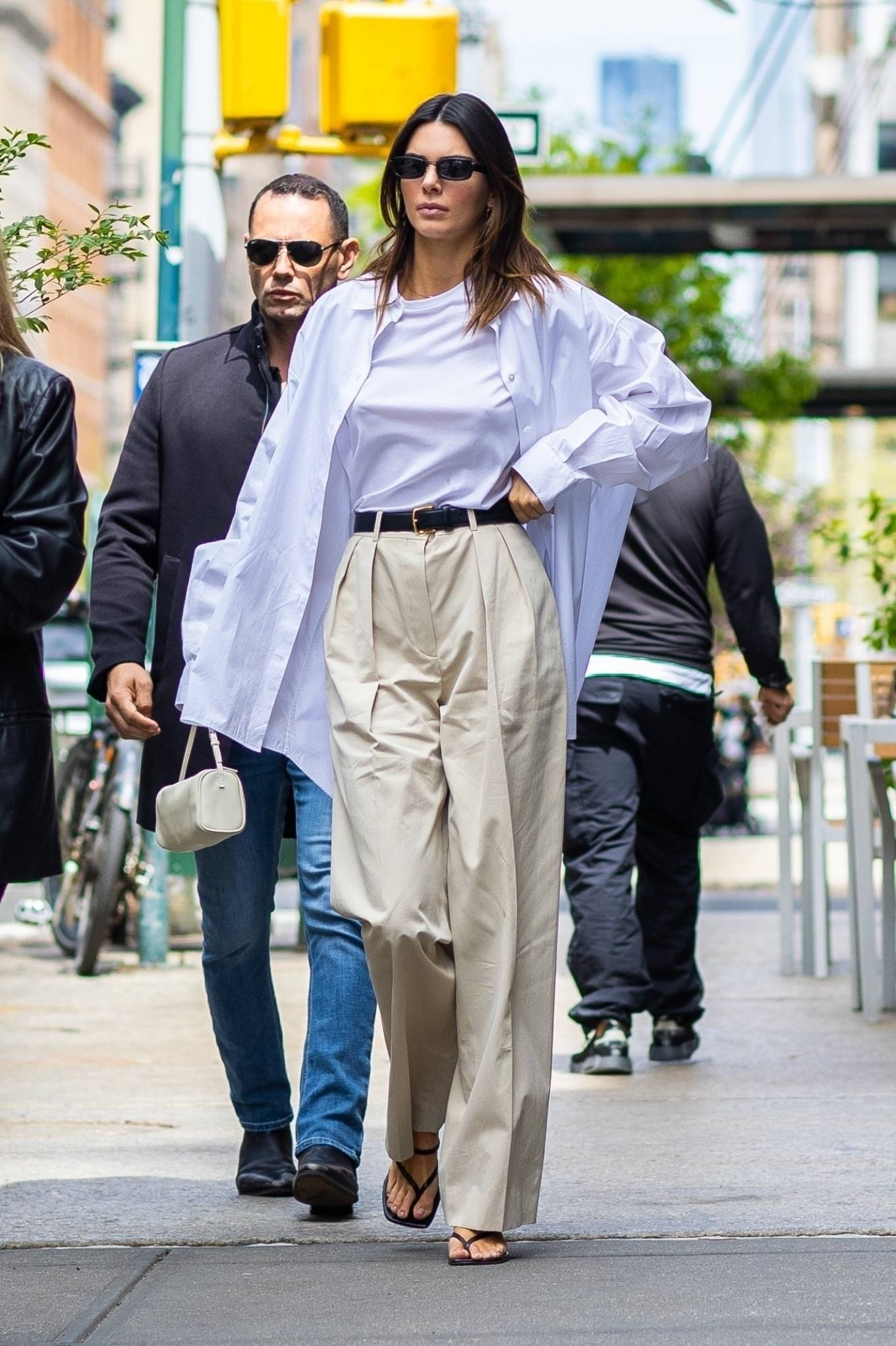 Kendall Jenner rocking a white cotton top with short sleeves and a crew neck