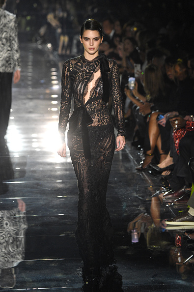 Kendall Jenner smouldered in black leather pumps by Tom Ford with high heel
