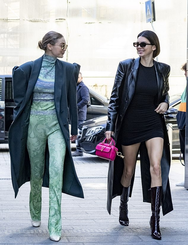 Kendall Jenner donning a formfitting black dress with a polyester material and a crew neck