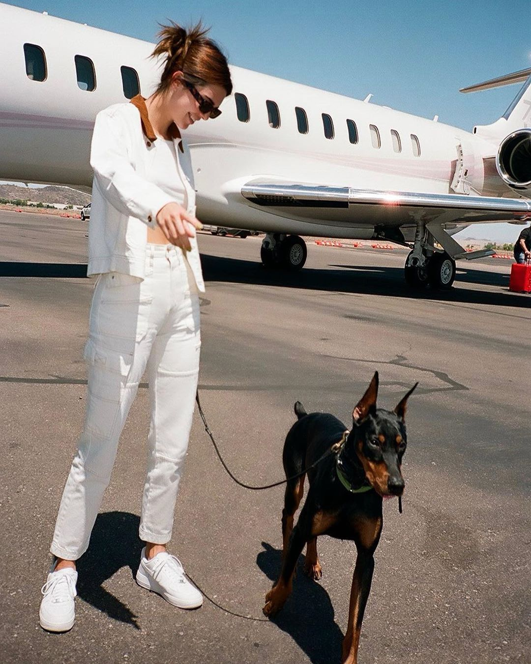 Kendall Jenner rocking straight fit white denim high waist jeans by Versace with piping