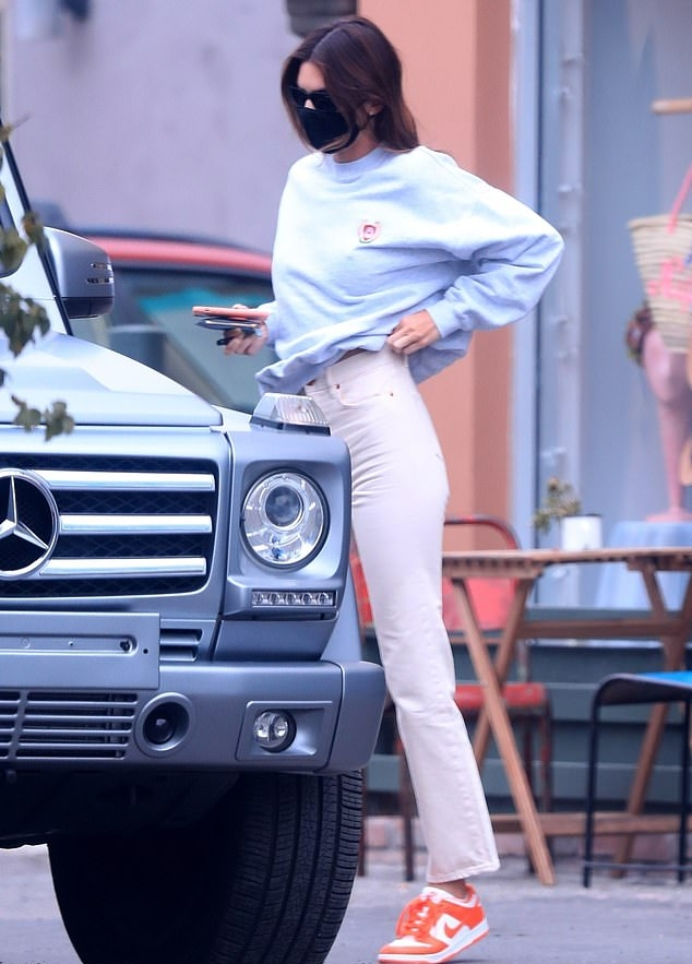 Kendall Jenner wearing straight fit white denim jeans
