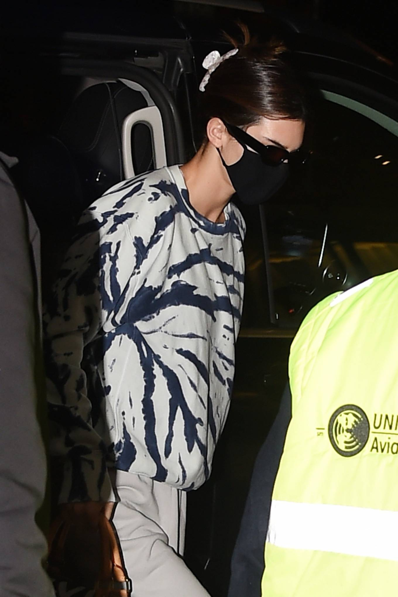 Kendall Jenner rocking light grey straight fit trousers